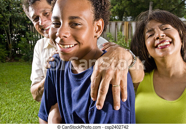 Teenage boy with proud parents - csp2402742