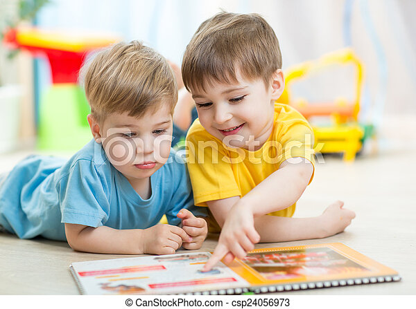 kids read a book at home or nursery