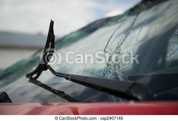 Broken windshield wiper on a broken car window - csp2407149
