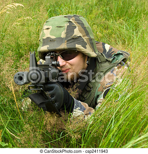Sniper laying in a grass - csp2411943