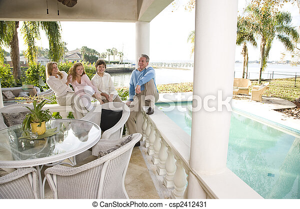 Family on vacation relaxing on terrace - csp2412431