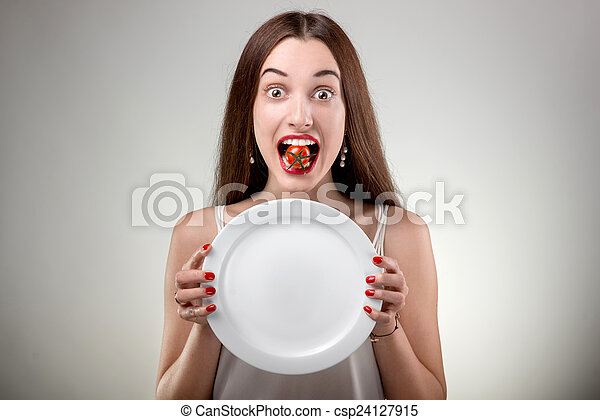 Young woman showing empty plate.