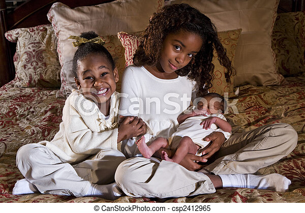 Sisters with newborn sibling - csp2412965