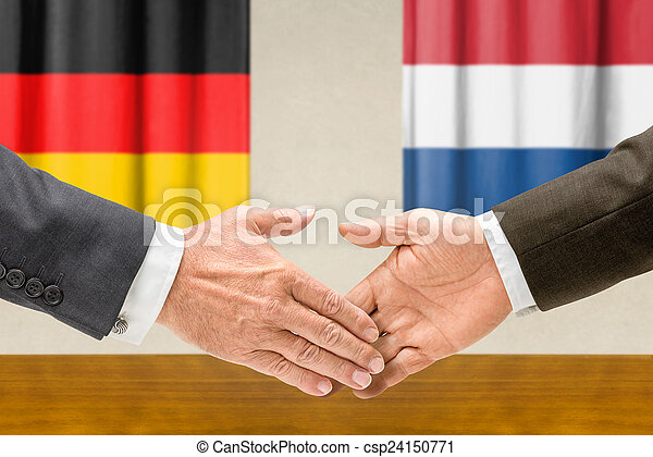 Representatives of Germany and the Netherlands shake hands