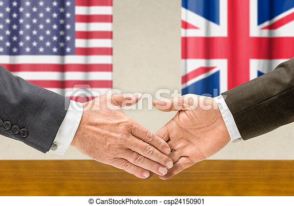 Representatives of the USA and the UK shake hands