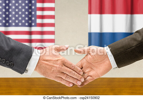 Representatives of the USA and the Netherlands shake hands