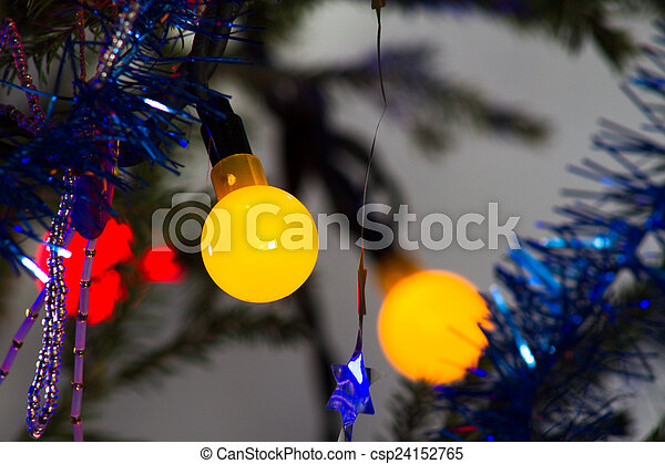 Bright garland on a Christmas tree abstract festive background