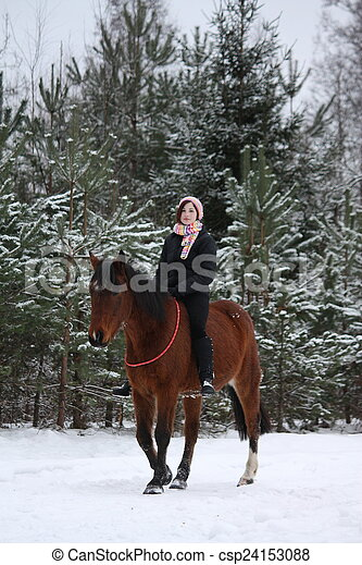 Teenager girl riding horse without saddle and bridle