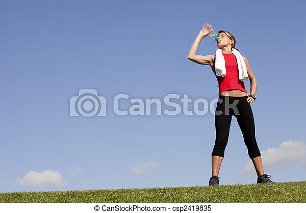 woman refreshing after the exercise - csp2419835
