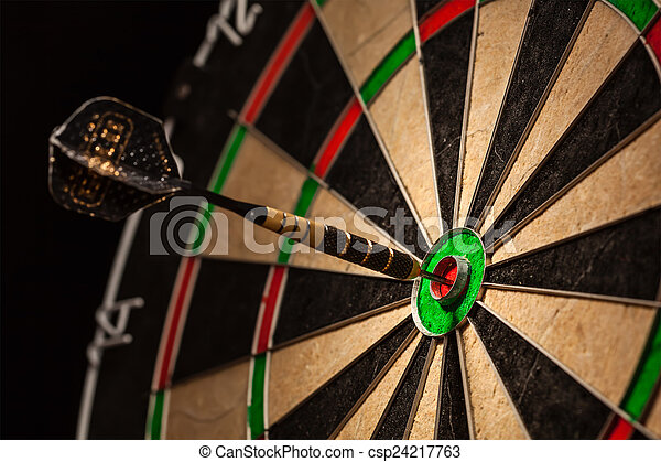 Dart in bull\'s eye close up