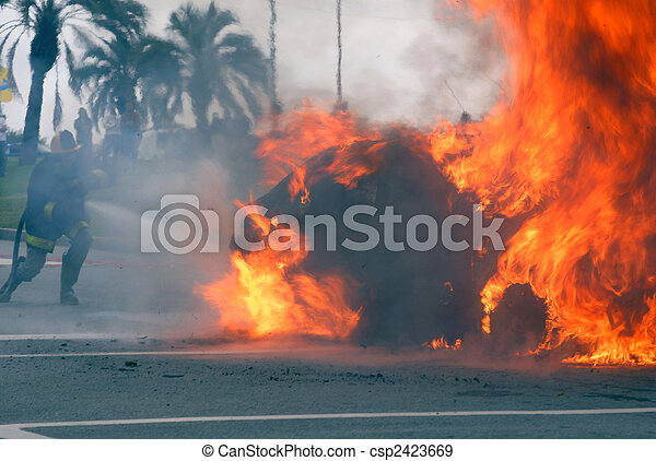 Car fire of a Citroen Xsara being extinguished by a firefighter at the corner of Concepci�n del Uruguay and Almer�a. Montevideo, Uruguay. - csp2423669