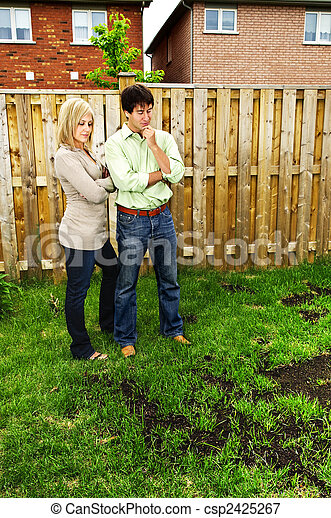 Couple concerned about lawn - csp2425267