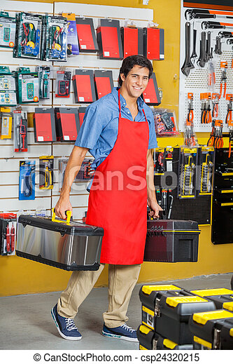 Salesman Carrying Toolboxes While Walking In Store