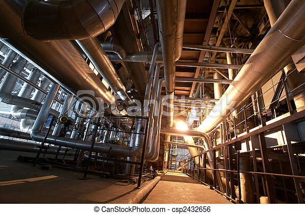 Equipment, cables and piping as found inside of a modern industrial power plant                - csp2432656