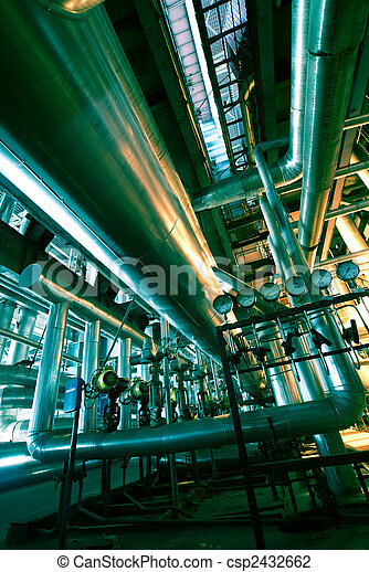 Equipment, cables and piping as found inside of a modern industrial power plant                    - csp2432662