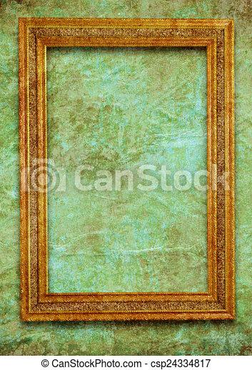 Golden frame on green wall