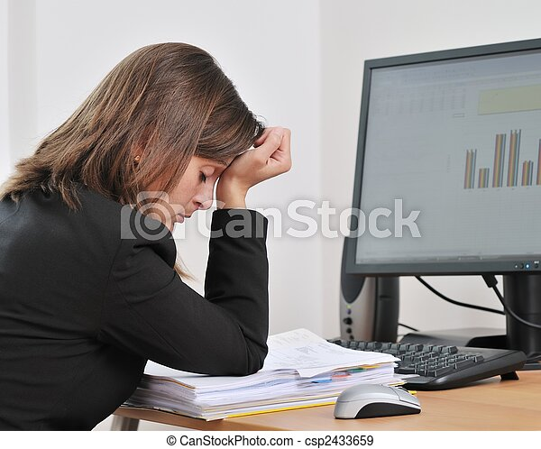 Depressed and tired business person in work - csp2433659