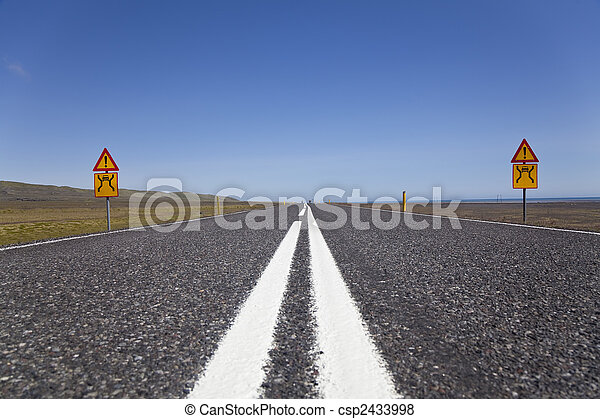 Wide Open Road With Warning Signs - csp2433998