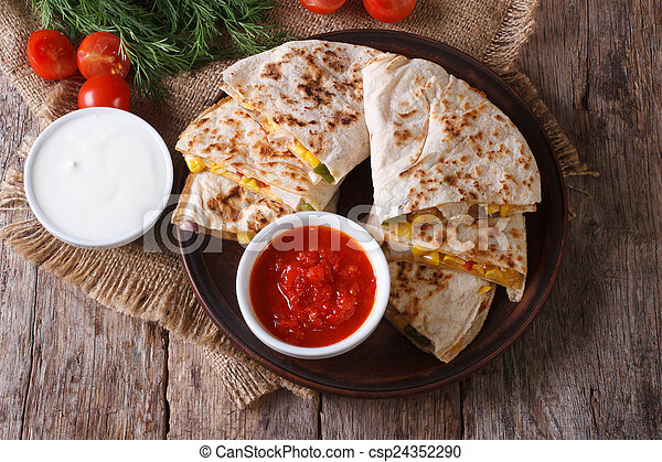 Quesadilla with vegetables and sauces. horizontal top view