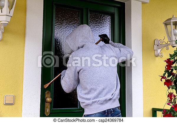 burglar at a house door - csp24369784