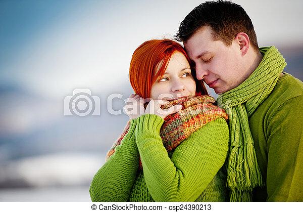 Happy couple in love outside in winter