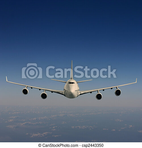 An Airliner in Flight over Clouds - csp2443350