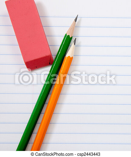 Pencils and an eraser on notebook paper - csp2443443