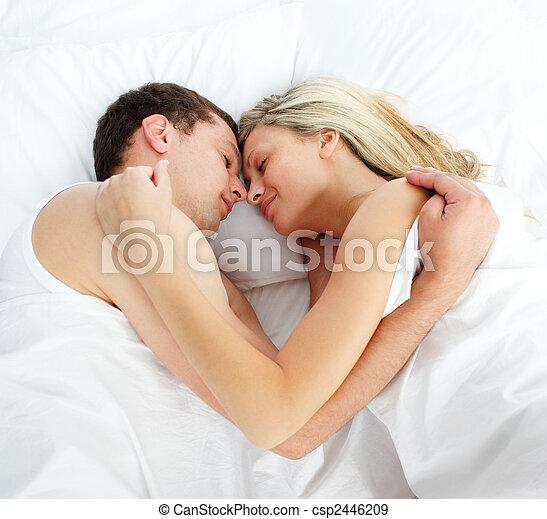 Boyfriend and girlfriend sleeping in bed - csp2446209