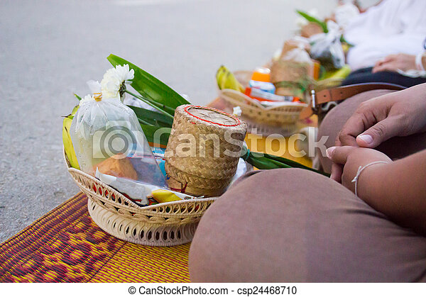 People wait for putting food to the buddhist monk