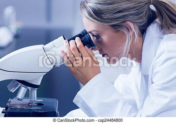 Science student looking through
