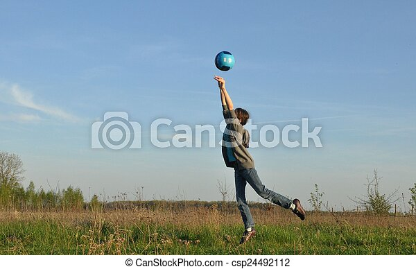 Teenager hits the ball. Sports on the open air