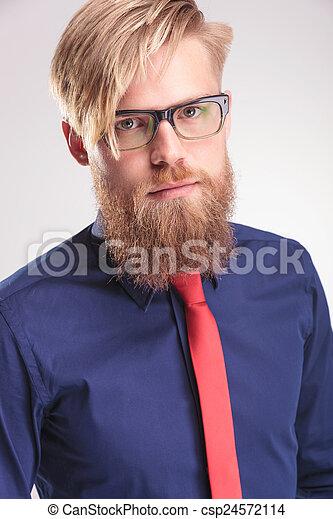 blond beard man wearing a blue shirt and red tie