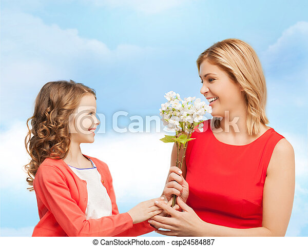 happy little daughter giving flowers to her mother - csp24584887