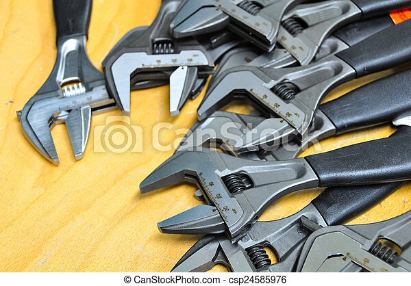set of hand tools on a wooden