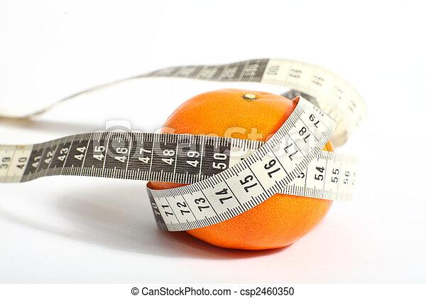 Metric tape measure and tangerine - csp2460350