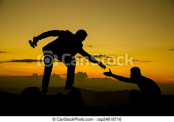 Businessman gived hand for pull team to peak of mountain