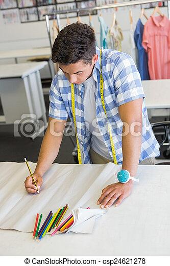 Fashion student drawing patterns