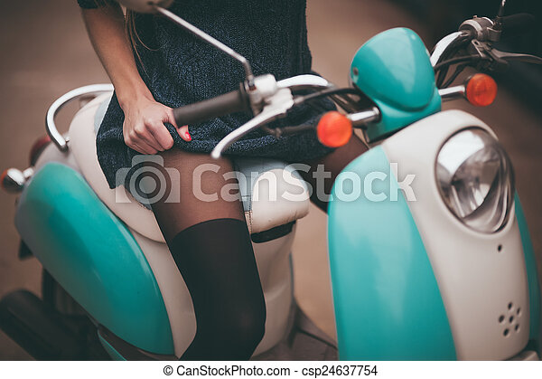 girl seating on moto bike