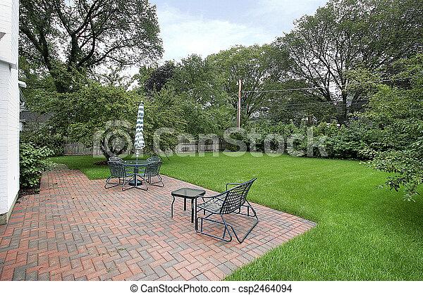 Brick patio and back yard - csp2464094