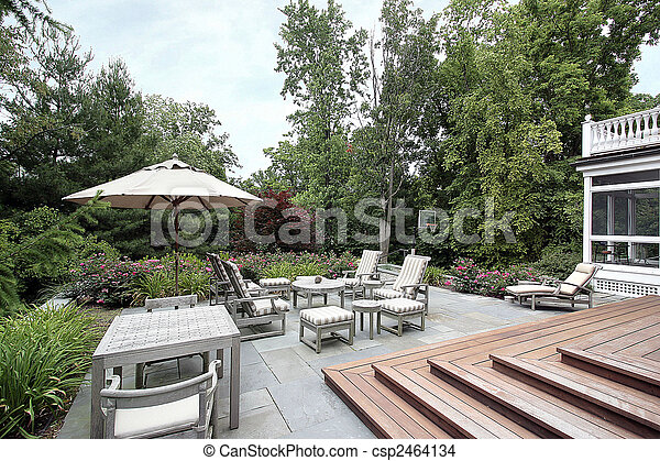 Slate patio with wooden stairs - csp2464134