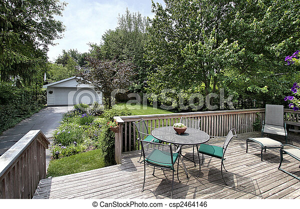 Deck and chairs leading to backyard - csp2464146