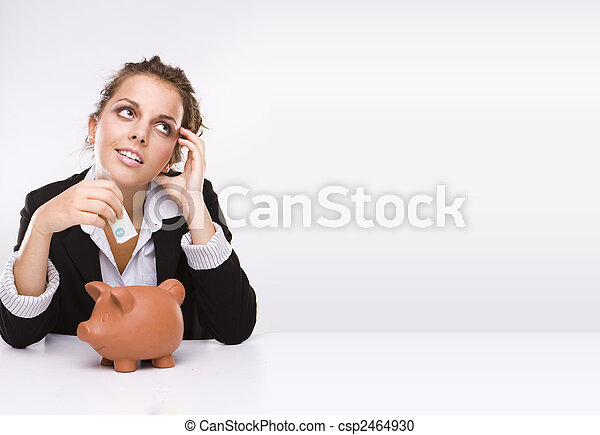 Savings - Business woman at work holding English  pound currency - csp2464930