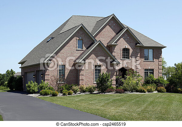 Luxury brick home with cedar shake roof - csp2465519