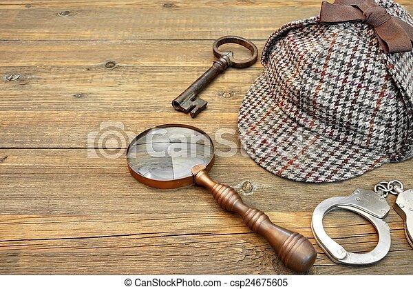 Sherlock Holmes Cap famous as Deerstalker, Key, Handcuffs and Ma - csp24675605