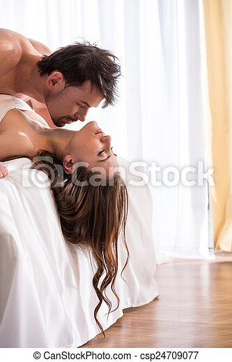 pic stock photo young romantic couple in sexual pose.