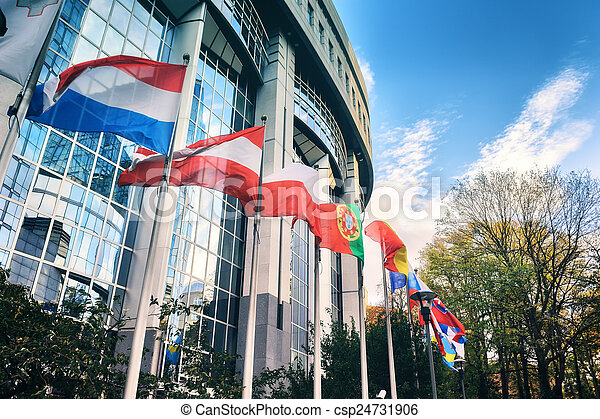Waiving flags in front of European Parliament building. Brussels - csp24731906