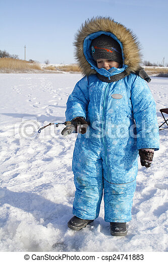 Winter fishing Young fisherman - csp24741883