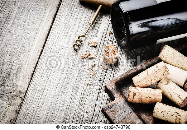 Bottle of red wine and corks