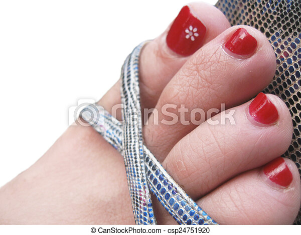 Stock Photo of Womans feet in the footwear with decorated ...