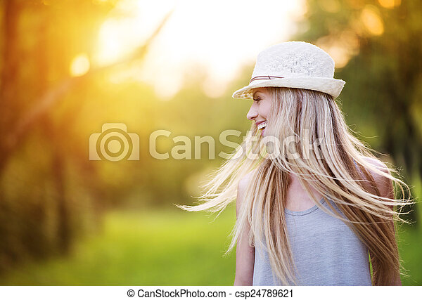 Beautiful woman outside in a park.